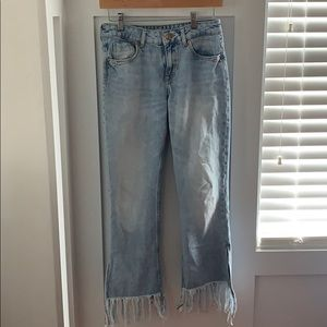 Zara light-wash destroyed fringe jeans